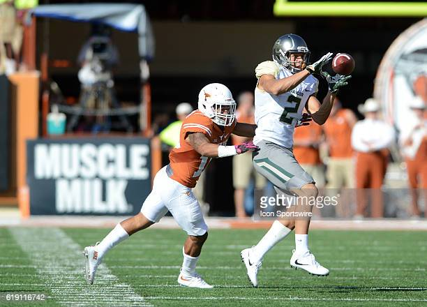 Texas DB P. J. Locke converges on Blake Lynch during NCAA game between Baylor and Texas on October 29, 2016 at Darrell K. Royal - Texas Memorial...