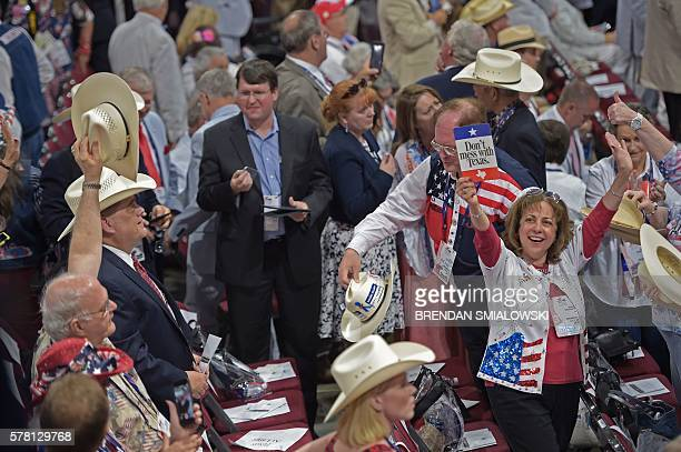 Texas delegate hoists a sign on day three of the Republican National Convention at the Quicken Loans Arena in Cleveland, Ohio on July 20, 2016. The...
