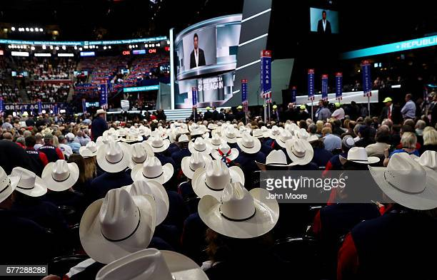 Texas delegates listen to former Navy SEAL Marcus Luttrell deliver a speech on the first day of the Republican National Convention on July 18 2016 at...