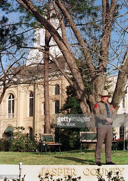 Texas Department of Public Safety trooper is stationed on the courthouse square for day one of the capital murder trial of Bill King at the Jasper...