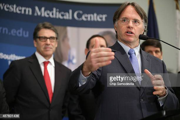 Texas Department of State Health Services Commissioner Dr. David Lakey and Texas Gov. Rick Perry hold a press conference with other health and...