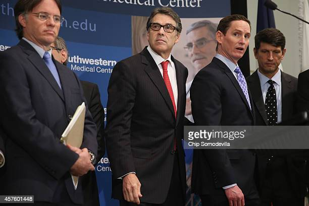 Texas Department of State Health Services Commissioner Dr. David Lakey, Texas Gov. Rick Perry and Dallas County Judge Clay Jenkins hold a press...