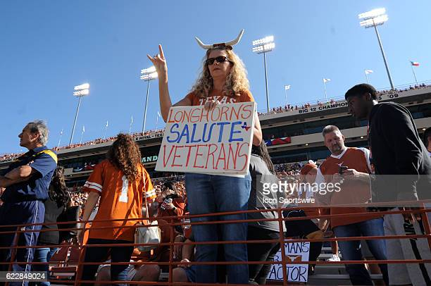 Texas fan honors military veterans during an NCAA football game between the West Virginia Mountaineers and the Texas Longhorns on November 12, 2016...