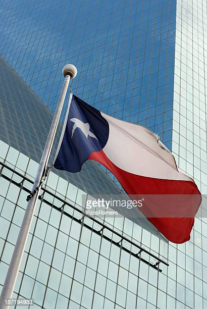Texas flag against glass office building
