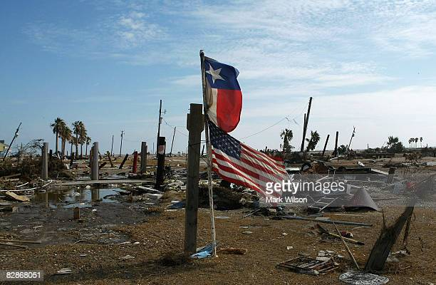 Texas flag and American flag fly over empty lots where homes once stood before Hurricane Ike came through the area September 17 2008 in Gilchrist...