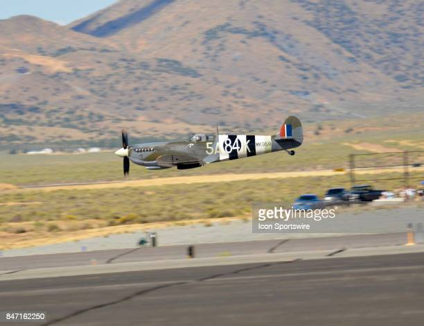 Texas Flying Legends Museum pilot makes a low pass over the runway in his Spitfire aircraft at the 54th National Championship Air Races the only...