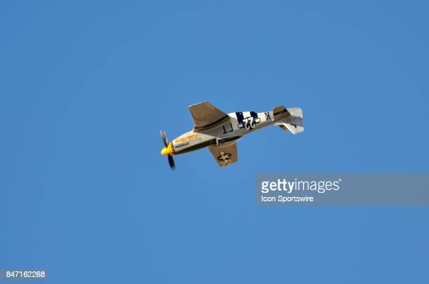 Texas Flying Legends Museum pilot Mark Murphy completes a barrel roll in his P51 Mustang at the 54th National Championship Air Races the only closed...