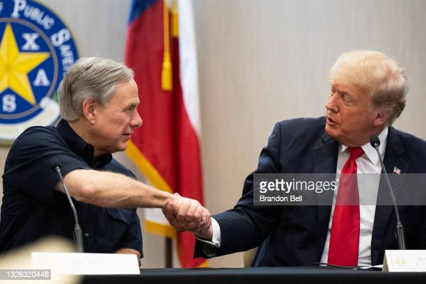 Texas Gov. Greg Abbott and former President Donald Trump shake hands during a border security briefing on June 30, 2021 in Weslaco, Texas. Gov....