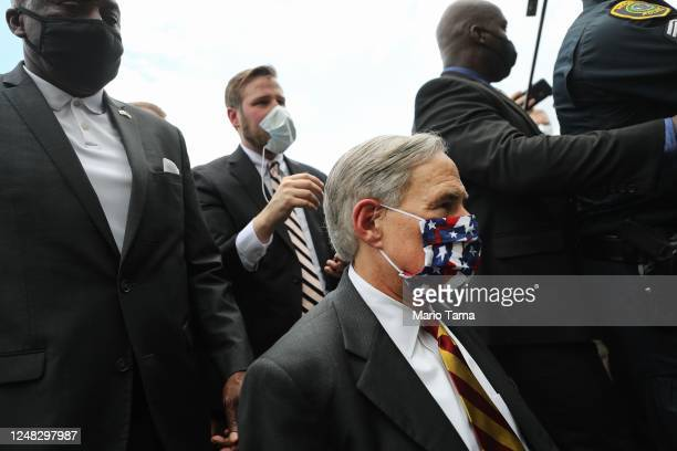 Texas Gov Greg Abbott approaches the line for people to attend the public viewing for George Floyd outside the Fountain of Praise church on June 8...