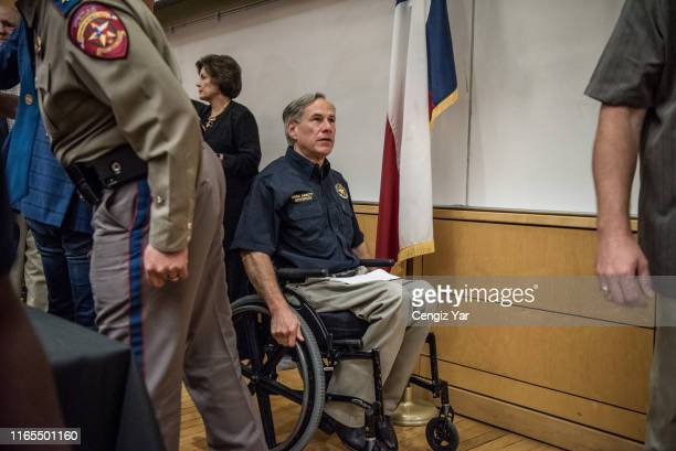 Texas Gov Greg Abbott leaves a press conference with local and federal law enforcement at the University of Texas of the Permian Basin following a...