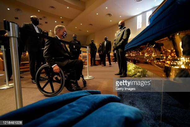 Texas Gov Greg Abbott passes by the casket bearing the remains of George Floyd at a public visitation at the Fountain of Praise church June 8 in...