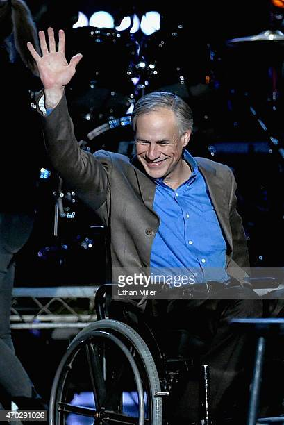 Texas Gov Greg Abbott speaks onstage during ACM Presents Superstar Duets at Globe Life Park in Arlington on April 18 2015 in Arlington Texas