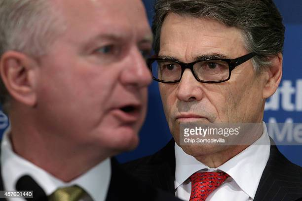 Texas Gov. Rick Perry and Texas Task Force on Infectious Disease Preparedness and Response Director Dr. Brett Giroir hold a press conference with...