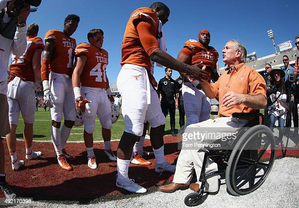 Texas Govenor Greg Abbott celebrates with the Texas Longhorns after they beat the Oklahoma Sooners 2417 during the ATT Red River Showdown at the...