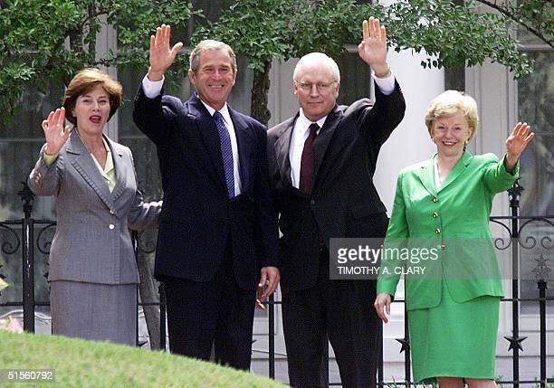 Texas Governor and Republican presidential candidate George W Bush and Vice Presidential running mate Dick Cheney wave with their wives Laura Bush...