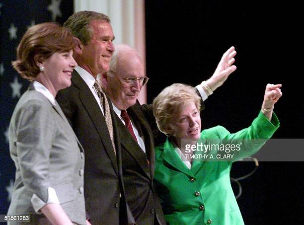 Texas Governor and Republican presidential candidate George W Bush and vice presidential running mate Dick Cheney pose with their wives Laura Bush...