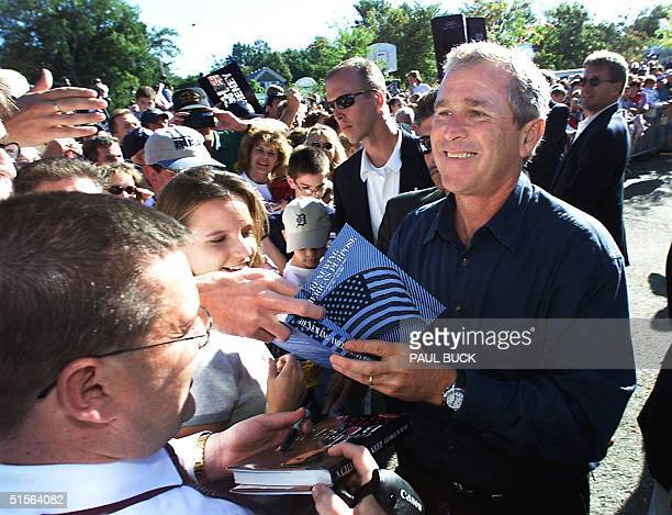 Texas Governor and Republican presidential candidate George W. Bush meets supporters following his speech at the Romeo Peach Festival 04 September...