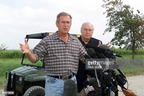 Texas Governor and Republican presidential candidate George W Bush and former US Secretary of Defense Dick Cheney speak to the press at Bush's ranch...