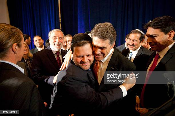 Texas Governor and Republican presidential hopeful Rick Perry hugs a supporter after a press conference in the Great Room at the W Hotel Union Square...