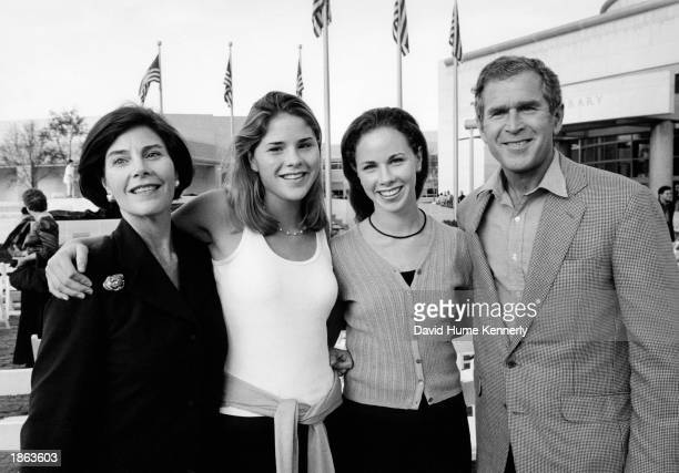 Texas Governor George Bush and wife Laura Bush flank daughters Jenna and Barbara at the Bush Library opening November 21 1999 in College Station Texas