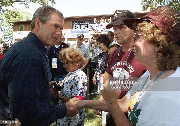 Texas Governor George Bush considered the frontrunning Republican candidate for US president urges his supporers to vote for him in the Republican...