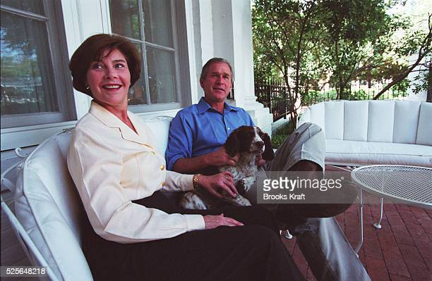Texas Governor George W Bush and his wife Laura sit at home with the family dog Spot Bush took time out to relax at home with the family pet during...