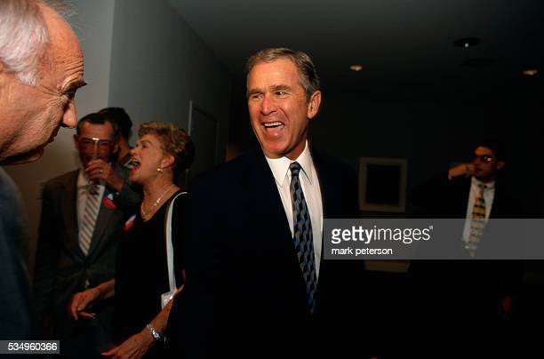 Texas governor George W Bush laughs during a post debate party for his 1998 campaign for reelection
