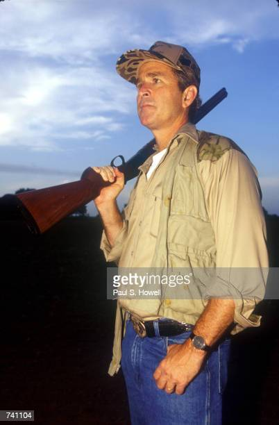 Texas Governor George W Bush looks for an opportunity on the first day of Dove hunting season in Hockley Texas September 1 1994