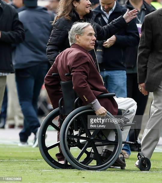 Texas governor Greg Abbott and his wife Cecelia attend the game between the Texas AM Aggies and Mississippi State Bulldogs at Kyle Field on October...