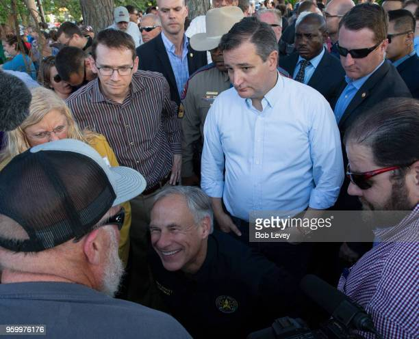 Texas Governor Greg Abbott and Sen Ted Cruz speaks to family and friends at a vigil held at the First Bank in Santa Fe for the victims of a shooting...