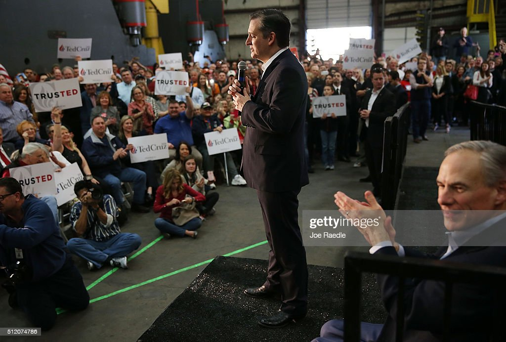 Texas Governor, Greg Abbott, (R) applauds as Republican presidential candidate U.S. Sen. Ted Cruz (R-TX) speaks during a campaign rally where the Texas governor endorsed him at the Mach Industrial Group on February 24, 2016 in Houston, Texas. The process to select the next Democratic and Republican Presidential candidates continues.