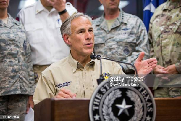 Texas Governor Greg Abbott delivers a briefing to the public on Hurricane Harvey at the Texas Department of Public Safety building on September 1...