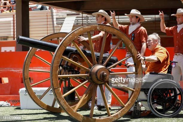 Texas Governor Greg Abbott fires Smokey The Canon to start the Texas Football Orange-White Spring Game at Darrell K Royal-Texas Memorial Stadium on...