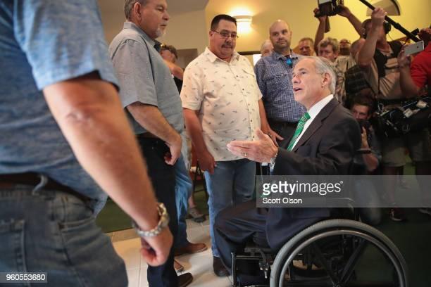 Texas Governor Greg Abbott greets members of Arcadia First Baptist Church near Santa Fe High School before Sunday service on May 20 2018 in Santa Fe...