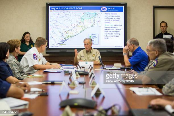 Texas Governor Greg Abbott is briefed on Hurricane Harvey at the Texas Department of Public Safety building on September 1 2017 in Austin Texas...