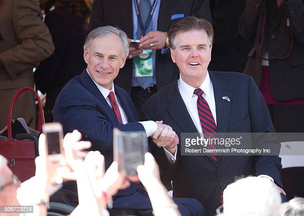 Texas Governor Greg Abbott l congratulates his colleague Lt Gov Dan Patrick as the two view the inaugural parade in downtown Austin Abbott becomes...