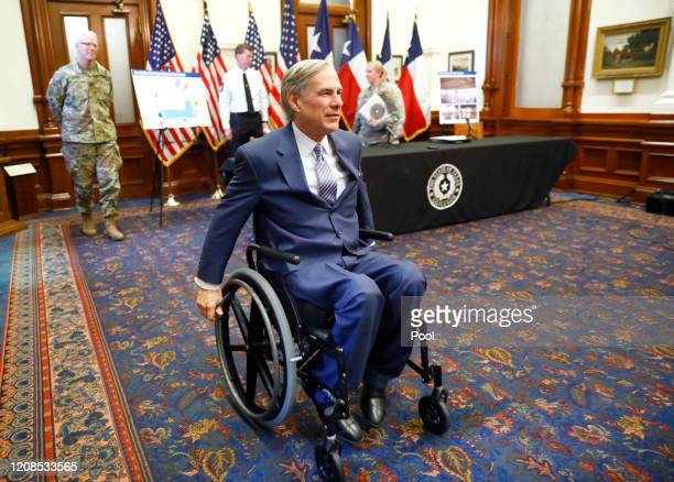 Texas Governor Greg Abbott leaves his COVID19 press conference at the Texas State Capitol in Austin He announced the US Army Corps of Engineers and...