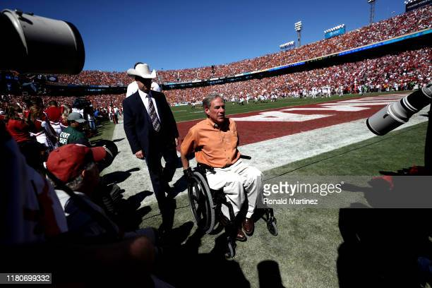 Texas Governor Greg Abbott leaves the field during the 2019 ATT Red River Showdown at Cotton Bowl on October 12 2019 in Dallas Texas