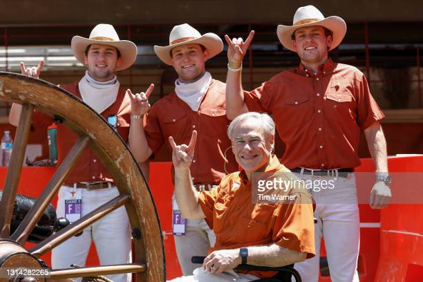 Texas Governor Greg Abbott poses for a photo with members of the Silver Spurs during the Texas Football Orange-White Spring Game at Darrell K...