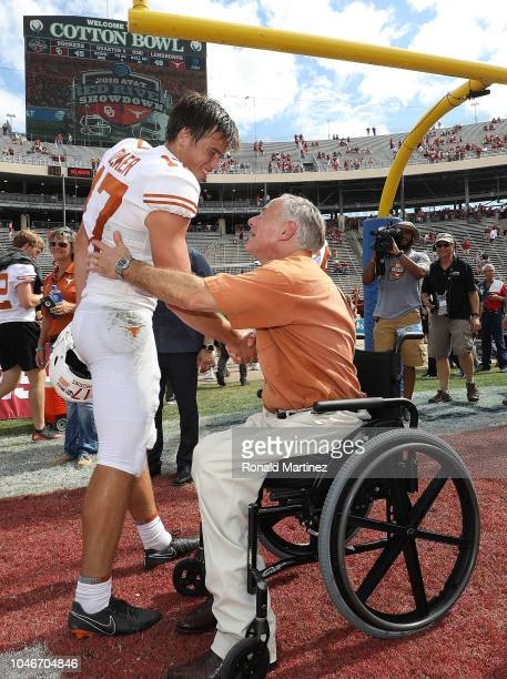 Texas Governor Greg Abbott shakes hands with Cameron Dicker of the Texas Longhorns after the 2018 ATT Red River Showdown at Cotton Bowl on October 6...