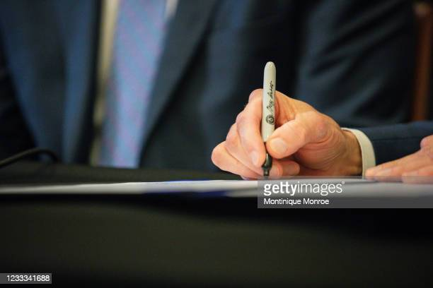 Texas Governor Greg Abbott signs Senate Bills 2 and 3 at a press conference at the Capitol on June 8, 2021 in Austin, Texas. Governor Abbott signed...