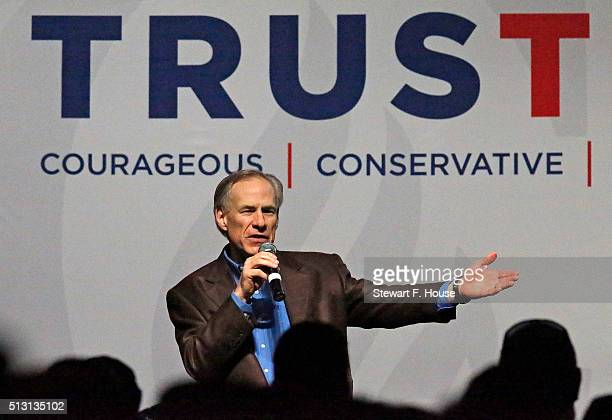 Texas Governor Greg Abbott speaks at a rally by Republican presidential candidate Sen Ted Cruz at Gilley's Dallas the day before Super Tuesday...