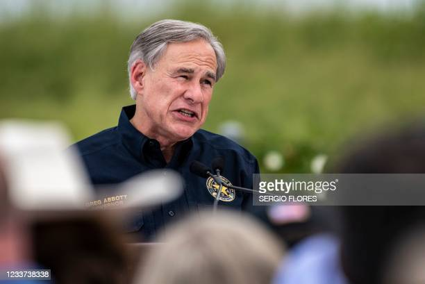 Texas Governor Greg Abbott speaks during a visit to the border wall near Pharr, Texas on June 30, 2021. - Former President Donald Trump visited the...