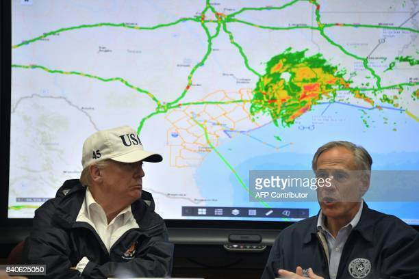 Texas Governor Greg Abbott speaks next to US President Donald Trump at the Texas Department of Public Safety Emergency Operations Center in Austin...