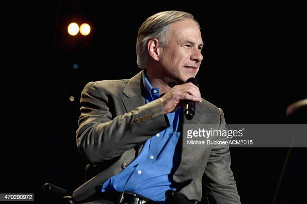 Texas Governor Greg Abbott speaks onstage during ACM Presents Superstar Duets at Globe Life Park in Arlington on April 18 2015 in Arlington Texas