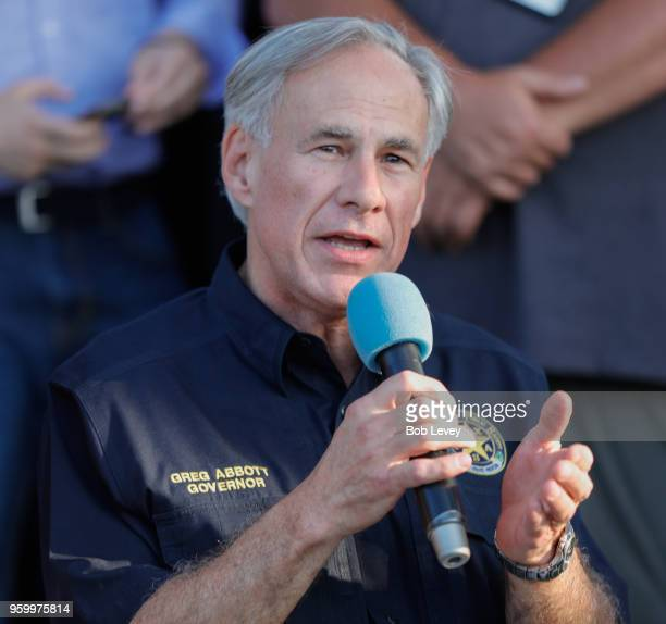 Texas Governor Greg Abbott speaks to family and friends at a vigil held at the First Bank in Santa Fe for the victims of a shooting incident at Santa...