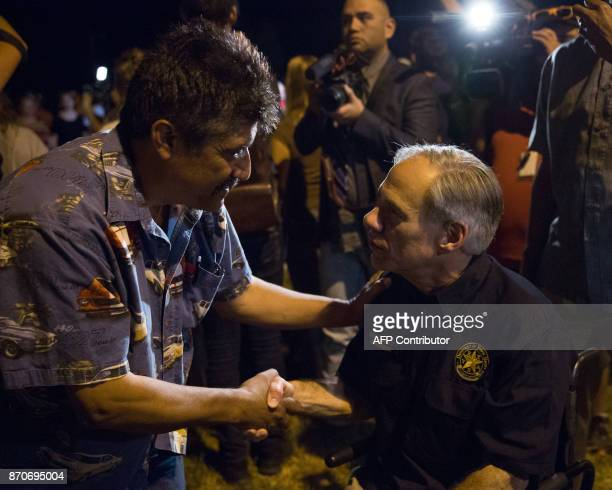 Texas Governor Greg Abbott speaks to local residents during a local resident during a candlelight vigil held on November 5 following the mass...