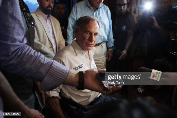 Texas Governor Greg Abbott speaks to the media following a vigil for victims at St Pius X Church, after a mass shooting which left at least 20 people...