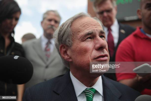 Texas Governor Greg Abbott speaks to the press during a visit to Santa Fe High School on May 20, 2018 in Santa Fe, Texas. Last Friday, 17-year-old...
