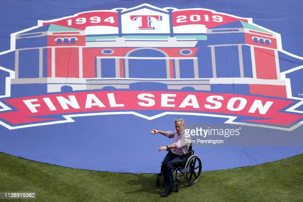 Texas Governor Greg Abbott throw out the ceremonial first pitch prior to the Texas Rangers taking on the Chicago Cubs during Opening Day at Globe...